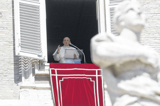 Pope Francis recites the Angelus noon prayer from his studio window overlooking St. Peter's Square, at the Vatican, Sunday. The pope strayed from his prepared text to double down on his frequent complaint about gossiping within church communities and even within the Vatican bureaucracy.