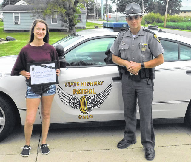 "Dystiny Marshall, of McGuffey, was presented a certificate and a license plate holder by Trooper John Sanders-Tirado of the Lima post of the Ohio State Highway Patrol as the newest member of Ohio's ""Saved by the Belt"" Club."