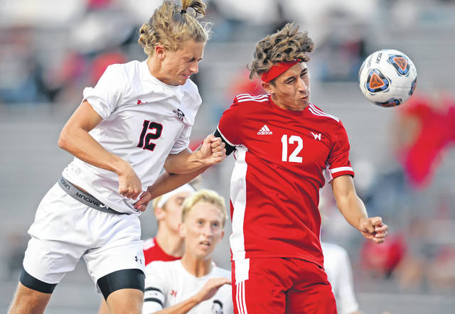 Shawnee's Jacob Miller, left, and Wapakoneta's Peyton Debell compete for the ball during Tuesday night's match in Wapakoneta. See more match photos at LimaScores.com.