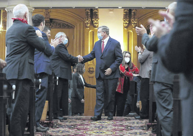 State Rep. Bob Cupp, R-Lima, center, is congratulated after being elected Speaker of the House at the Ohio Statehouse on July 30.
