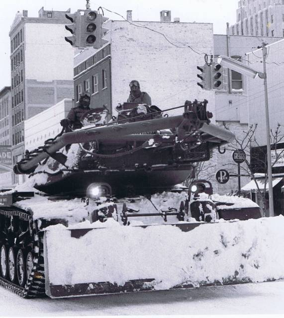 A tank with a snow blade rolls through downtown Lima during the Blizzard of 1978.