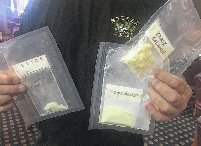 Detective Mike Haines, a member of the West Central Ohio Task Force, on Wednesday showed members of the Lima Noon Optimist Club examples of the various illicit drugs that are available on the streets of Lima and throughout Allen County. Because of his work as an undercover officer, Haines asked that his face not be shown.