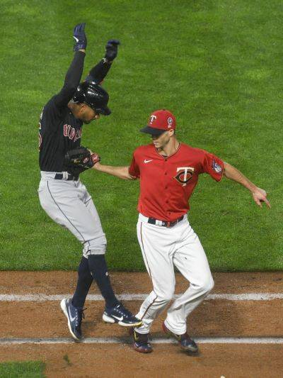 The Minnesota Twins' Taylor Rogers tags out Cleveland's Oscar Mercado, after Mercado hit a short ground ball, for the final out of Friday night's game in Minneapolis. (AP photo)