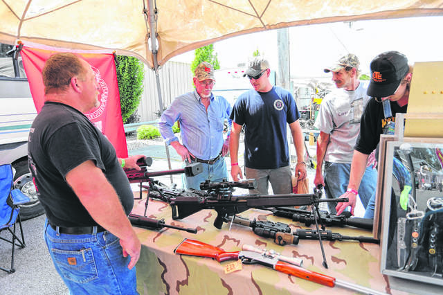 Guests come from all around the country to buy and sell guns and antiques during the annual Max's Trader Days and Waterdog Races at the Allen County Fairgrounds.