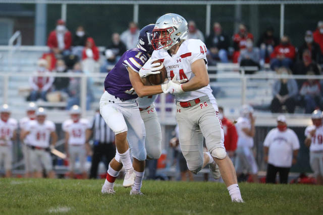 Pandora-Gilboa's Sam Burkholder fights for yardage against Leipsic's Hayden Hiegel during Friday night's game at Leipsic. Head to LimaScores.com for more game photos.