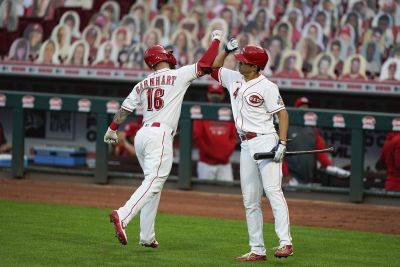 The Reds' Tucker Barnhart (16) celebrates with Shogo Akiyama (4) after hitting a home run during Tuesday night's game against Pittsburgh in Cincinnati. (AP photo)