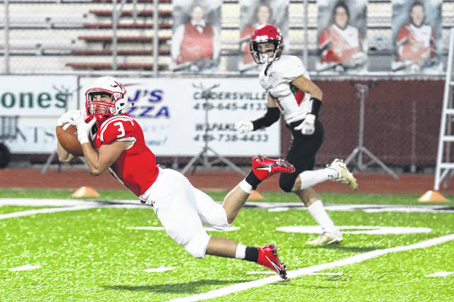 Wapakoneta's Jacob Schroeder dives to make a catch during Friday night's home game against Shawnee. See more game photos at LimaScores.com.
