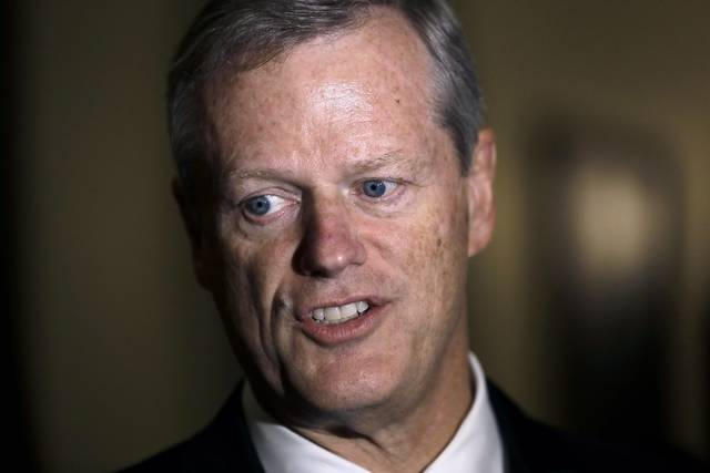 FILE - In this Monday, Sept. 16, 2019 file photo Massachusetts Gov. Charlie Baker speaks with reporters at the Statehouse, in Boston. The National Bobblehead Hall of Fame and Museum in Milwaukee on Thursday, Oct. 8, 2020 said they are taking preorders for Baker bobblehead dolls, and said $5 from the $25 cost of each one will be donated to the Protect The Heroes fund's 100 Million Mask Challenge that pays for protective equipment for health care workers nationwide. (AP Photo/Steven Senne, File)