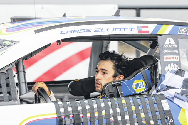 Chase Elliott drives into victory lane after winning a NASCAR Cup Series auto race at Charlotte Motor Speedway in Concord, N.C., Sunday, Oct. 11, 2020. (AP Photo/Nell Redmond)