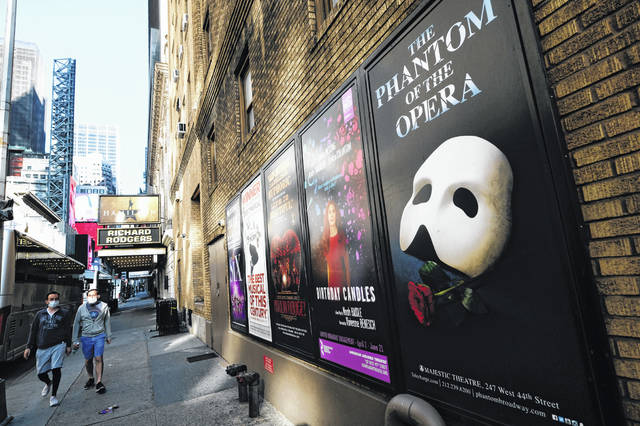 Broadway posters show canceled shows outside the Richard Rodgers Theatre in New York in May. Broadway theaters may be dark but there will be plenty of new online productions of some classic plays this fall.