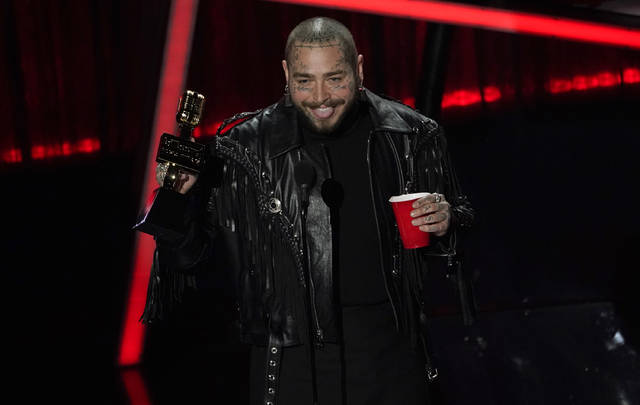 Post Malone accepts the top artist award at the Billboard Music Awards on Wednesday at the Dolby Theatre in Los Angeles.