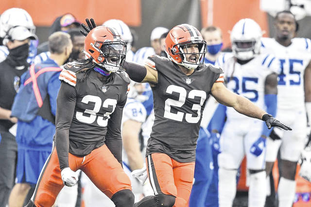 Cleveland Browns defensive backs Ronnie Harrison (33) and Andrew Sendejo (23) celebrate an incomplete pass during the Browns' 32-23 win over the Indianapolis Colts on Sunday.