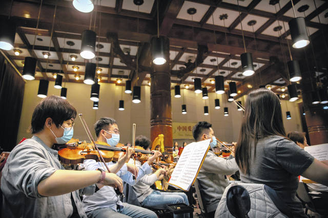 Musicians from the Wuhan Philharmonic Orchestra rehearse a day before their concert to open the Beijing Music Festival, China's first classical music festival since the beginning of the COVID-19 outbreak, in Beijing, Friday, Oct. 9, 2020. China is holding its first classical music festival since the outbreak of the coronavirus pandemic featuring musicians from the global epicenter of Wuhan, in an attempt to aid in the psychological and emotional healing process.