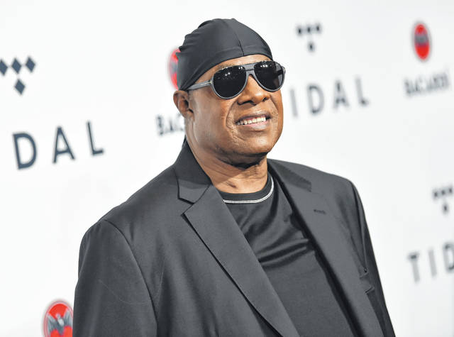 """FILE - In this Oct. 17, 2017, file photo, Stevie Wonder attends the TIDAL X: Brooklyn 3rd Annual Benefit Concert in New York. Wonder released two new songs Tuesday reflecting the current times that he hopes inspires change. The music icon dropped the tracks """"Where Is Our Love Song"""" and """"Can't Put It In the Hands of Fate,"""" which he also announced would be released through his new label, So What the Fuss Music, distributed through Universal Music Group's Republic Records."""