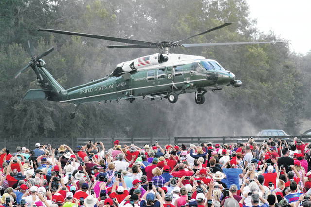 President Donald Trump arrives in the Marine One helicopter at a campaign rally as supporters cheer Friday, Oct. 23, 2020, in The Villages, Fla.
