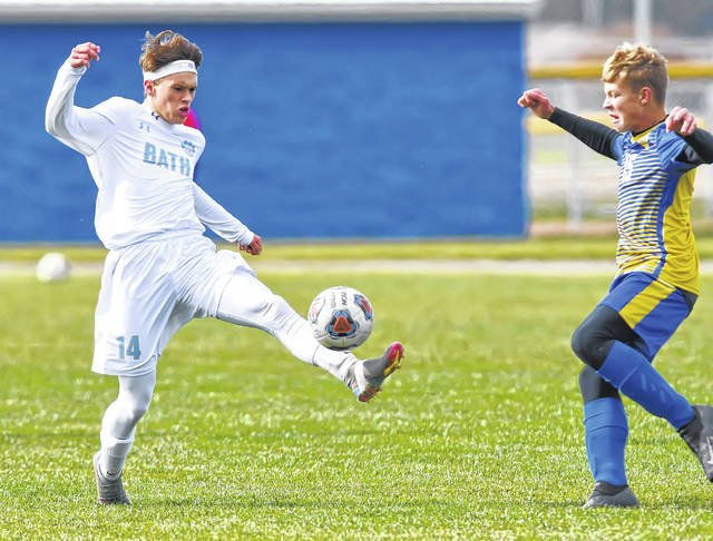 Miller City's Evan Schroeder defends Bath's Keaton Liles during Saturday's Division III sectional final at Miller City. See more match photos at LimaScores.com.