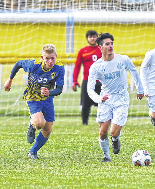 Miller City's Owen Tobe pursues Bath's Harrison Abrams during Saturday's Division III sectional final at Miller City.