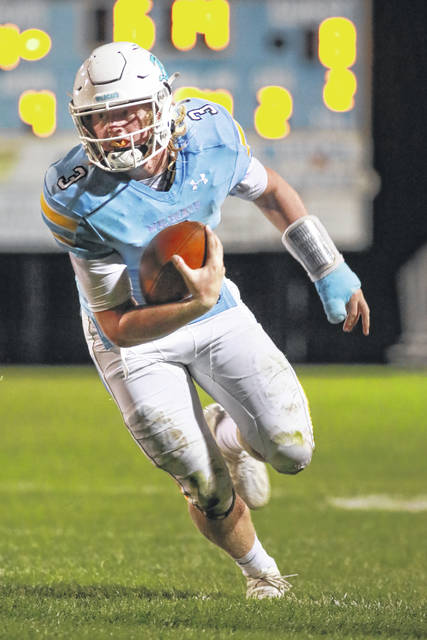 Bath's Trent Weigel carries the ball during Saturday night's Divisioni V home playoff game Swanton.