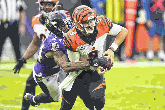 Cincinnati Bengals quarterback Joe Burrow (9) is sacked by Baltimore Ravens cornerback Marcus Peters (24) during the Ravens' 27-3 win over the Bengals on Sunday. Burrow was sacked seven times in the game.