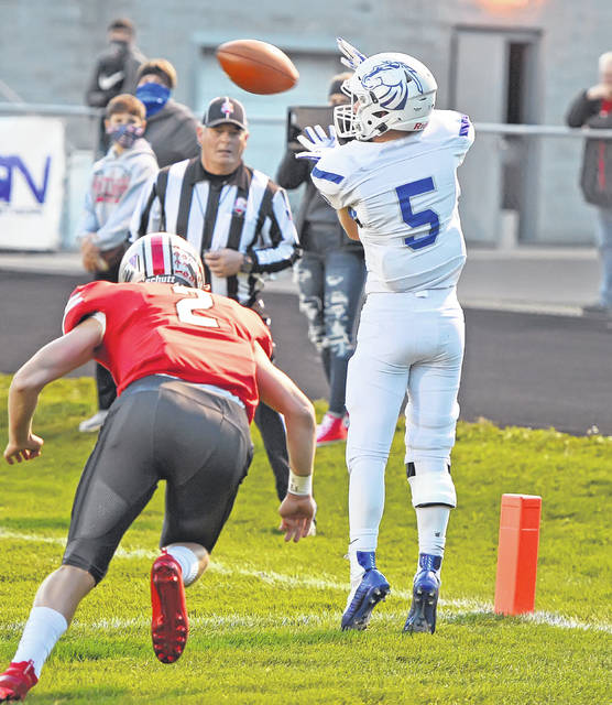 Allen East's Gavin Maxwell hauls in a touchdown pass against Columbus Grove's Blake Reynolds during Friday night's game at Columbus Grove.