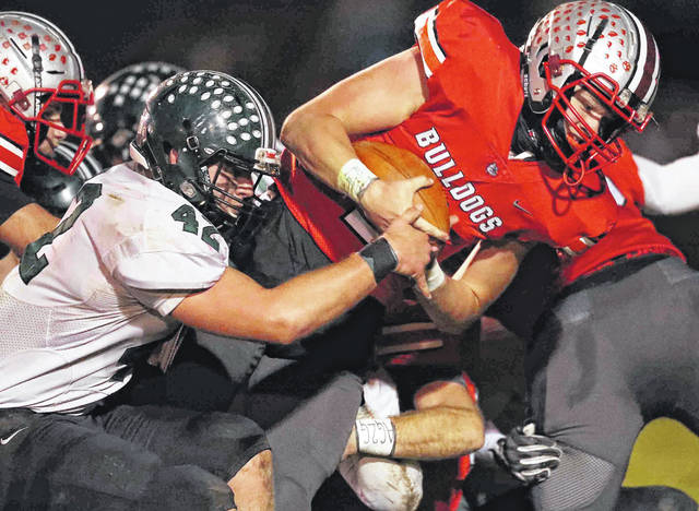 Columbus Grove's Blake Reynolds crosses the goal line for a touchdown against Tinora's Casen Wolfrum during Saturday night's Division VI playoff game at Columbus Grove.