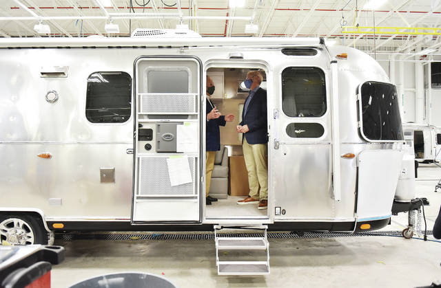 U.S. Secretary of the Interior David L. Bernhardt, left, and Airstream President and CEO Bob Wheeler, talk inside an Airstream trailer under construction in the Airstream manufacturing plant in Jackson Center on Wednesday, Oct. 14.