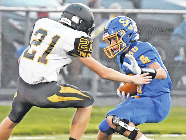 Braysen Schulte from Delphos St. John's tries to get past Hardin Northern's Wesley Newton during Friday night's Division VII playoff game at Stadium Park in Delphos. See more game photos at LimaScores.com.