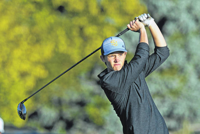 Jack Gerker of Delphos St. John's watches his tee shot on the 10th hole during Thursday's Division III district tournament at Stone Ridge Golf Club in Bowling Green.