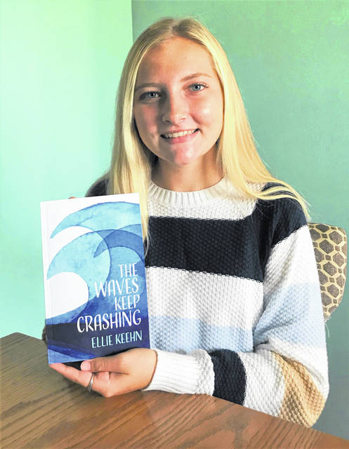 """Ellie Keehn, a sophomore at Columbus Grove High Schools, holds the book, """"The Waves Keep Crashing,"""" which she started writing in the seventh grade. The book was published earlier this month and can be purchased through Amazon or Barnes & Noble. As far as a second book, Ellie says, """"Right now I think I'll just enjoy this."""""""