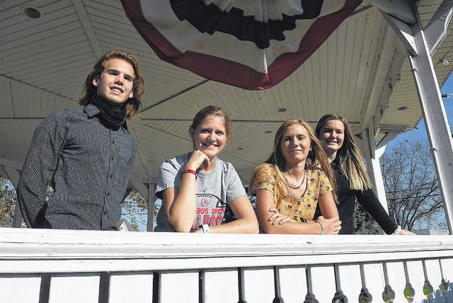Several first-time voters at Columbus Grove High Schoolgather at the Village Park gazebo, including, from left, Cody Tabler, 18; Zoe Stechschulte, 18; Lauryn Wischmeyer, 18; and Grace Selhorst, 18.
