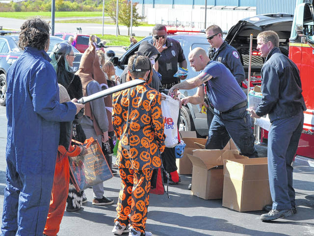 Shawnee Township policeofficers and firefighters were on hand at the Lima Harley-Davidson dealership Saturday for the Fright the Hunger Trunk or Treat.