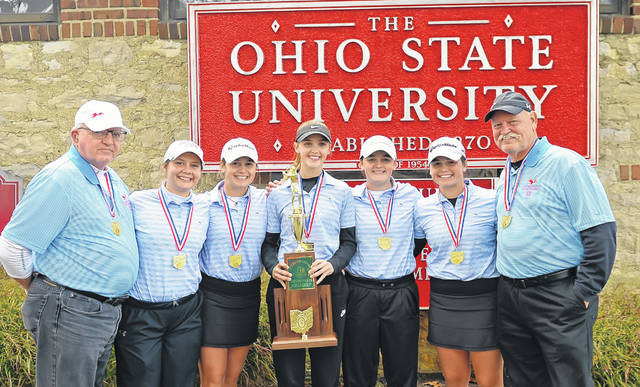 Standing with the Division II girls state golf championship trophy from Lima Central Catholic at the Ohio State Gray Course are, from left: Assistant Coach Pete Hubbell, Carlie VanMeter, Erin Mulcahy, Emma Mayers, Bridget Mulcahy, Mary Kelly Mulcahy and Head Coach Daniel Reinicke.