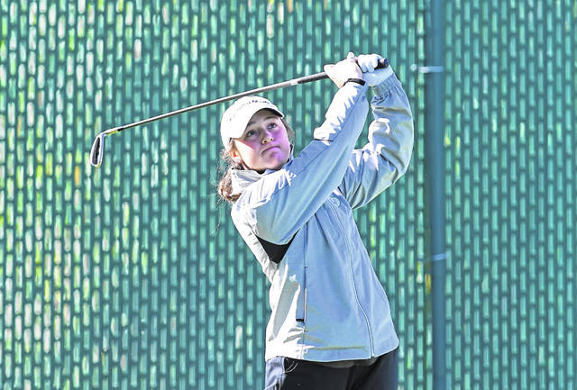 Lima Central Catholic's Erin Mulcahy watches her shot from the fourth tee during Friday's first round of the Girls Division II Golf State Tournament at Ohio State's Gray Course.