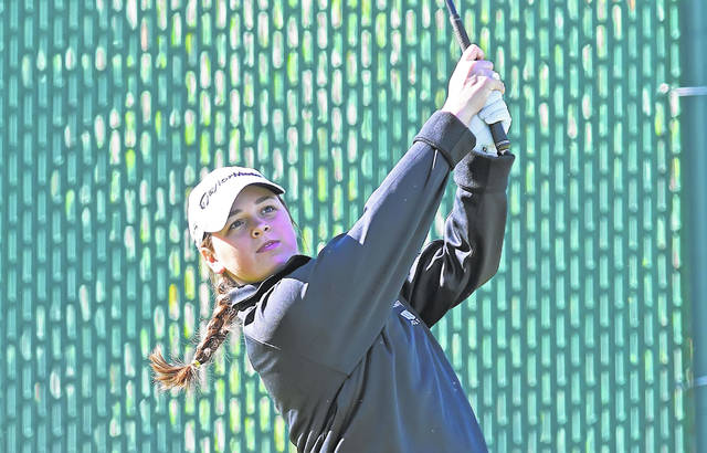 Lima Central Catholic's Mary Kelly Mulcahy watches her shot from the fourth tee during Friday's first round of the Girls Division II Golf State Tournament at Ohio State's Gray Course. See more state tournament photos at LimaScores.com.