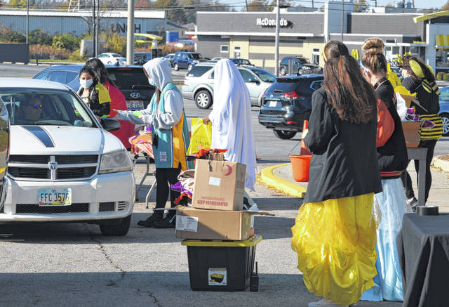 The Lima Mall's traditional candy crawl changed to a drive-thru trick or treat event Saturday.