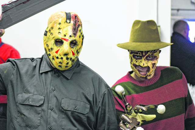 Tyler Mills, dressed as Jason, and Emma Nelson, appearing as reddie Kruger, attended a Halloween event last year in downtown Lima.