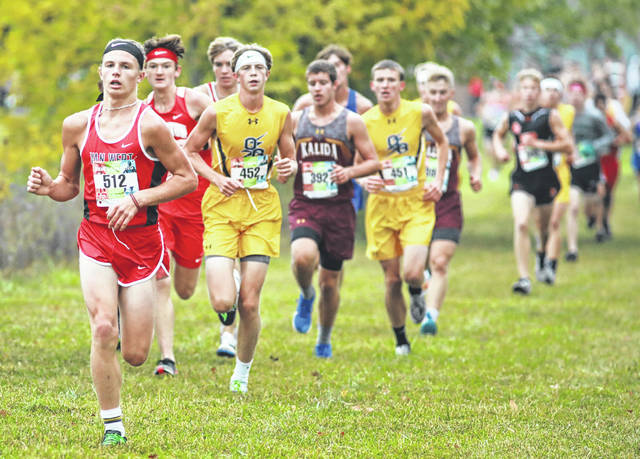 Van Wert's Gage Springer (512) leads a pack of runners, including Ottawa-Glandorf's Max Buddelmeyer, during Saturday's Kalida Wildcat Invitational at the Kalida Fish and Game Club. See more invitational photos at LimaScores.com.