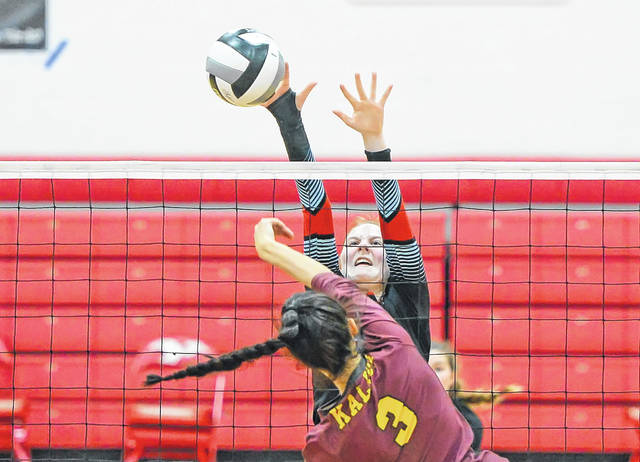 Lima Central Catholic's Emma Frueh defends a spike by Kalida's Lydia Vorst during Tuesday night's Division IV sectional semifinal at LCC.