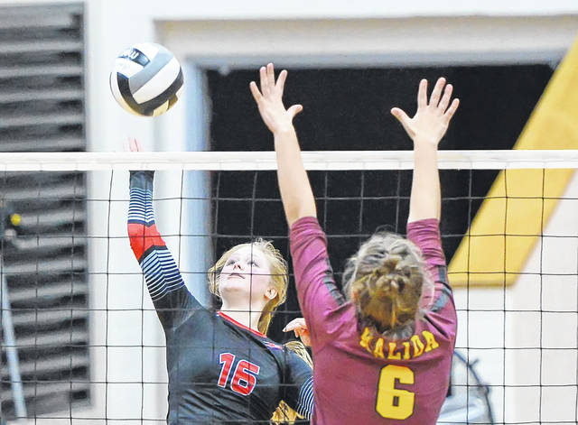 Lima Central Catholic's Grace Hutgens hits a spike against Kalida's Brooke Vennekotter during Tuesday night's Division IV sectional semifinal at LCC. See more match photos at LimaScores.com.