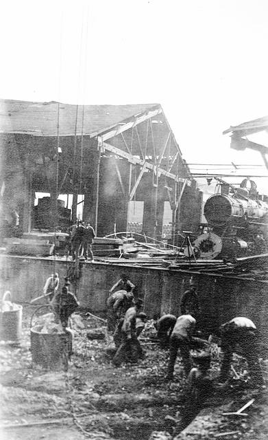 Men work to clean up after a terrible fire at Lake Erie & Western railroad in 1918. It caused more than $800,000 damage to the rail yards, which sprawled along the L.E.&W. tracks west of South Main Street and just north of the newly opened station No. 6 at the corner of South Main and Lafayette streets.