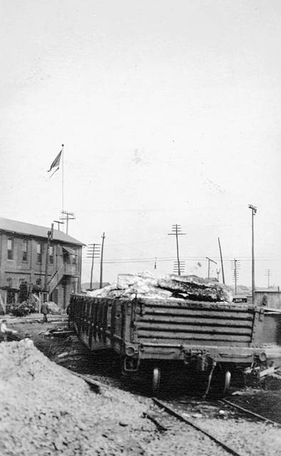 A railcar holds debris from the fire as clean up began in 1918.