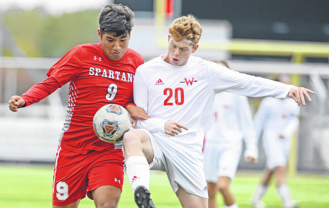 Lima Senior's Javier Birto-Diaz (9) and Wapakoneta's Brayden Schlenker compete for the ball during Saturday's match at Spartan Stadium. See more match photos at LimaScores.com.
