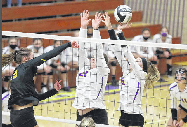 Leipsic's Kasey Brough, left, and Peyton Heitmeyer defend a spike by Miller City's Abi Teders during Thursday night's Division IV district final at Leipsic. See more match photos at at LimaScores.com.