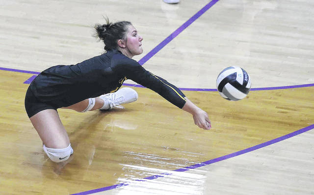 Miller City's Adi Niese hits the floor to reach a serve during Thursday night's Division IV district final against Miller City at Leipsic.