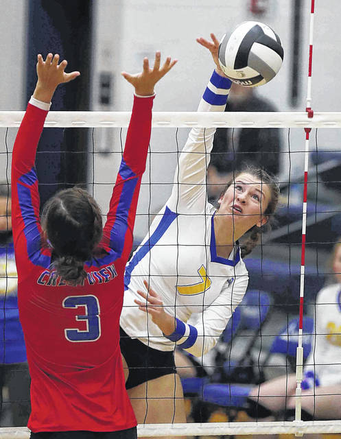 Lincolnview's Madison Williams hits a spike against Crestview's Gregory during Thursday night's match at Lincolnview.
