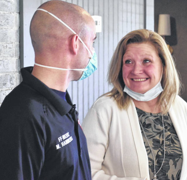 Lima firefighter Matt Hammons and Hellen Douglas were reunited Tuesday during a meeting of the Lima Kiwanis Club. In 2018 Hammons rescued Landyn Douglas, Hellen's grandson, from a burning building. The two have formed a lifelong bond.