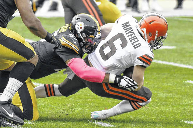 Cleveland Browns quarterback Baker Mayfield (6) is tackled by Pittsburgh Steelers defensive end Cameron Heyward (97) on a scramble during the first half of the Steelers' 38-7 win over the Browns on Sunday in Pittsburgh.