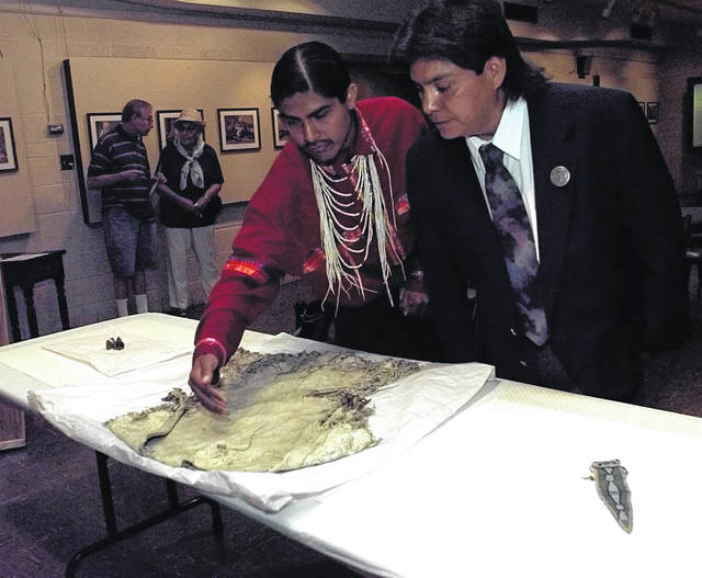 Samuel N. Penney, left, and Josiah Pinkham of the Nez Perce look over artifacts donated to the Allen County Historical Society during a ceremony in August 1998.
