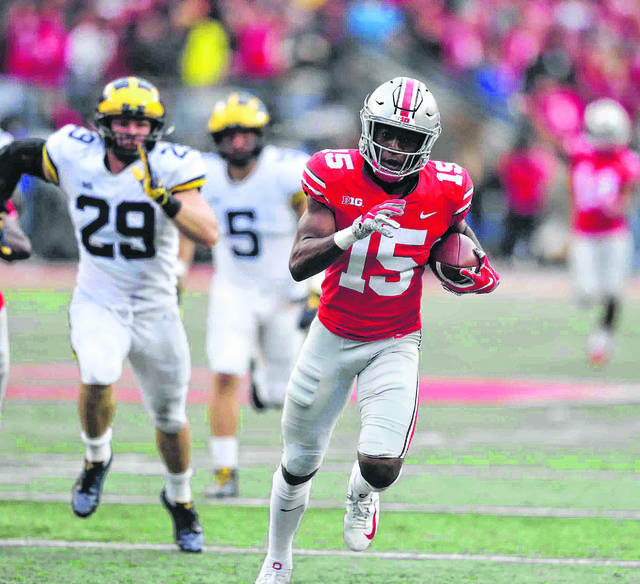Ohio State cornerback Sevyn Banks returns a blocked punt for a touchdown during the 2018 Ohio State-Michigan game.