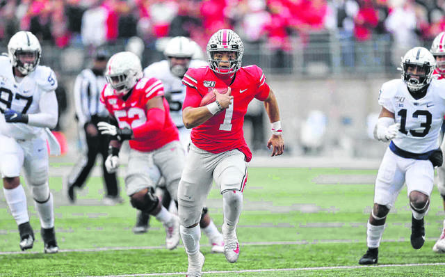 Ohio State quarterback Justin Fields finds some running room in a game against Penn State last season.